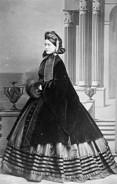 Victorian 1860s fashion: paletote (overcoat), hat, fur muff. How many yards of material was used to make dresses like this one?
