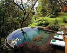 Small pool hot tub - with infinity edge and beds for lounging...can i please have a rich husband?