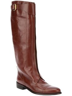 Brown leather boots from Burberry London featuring mid-rise calfs length, top strap details with gold tone details, front gold tone zipper details, almond toes and flat soles