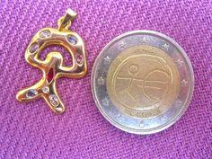 Regalo afortunado del Indalo: Colgante de oro con gemas