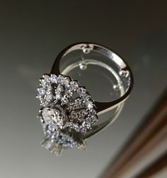 18k White Gold and Diamonds. Vintage Engagement Ring. Just beautiful! I LOVE my ring.