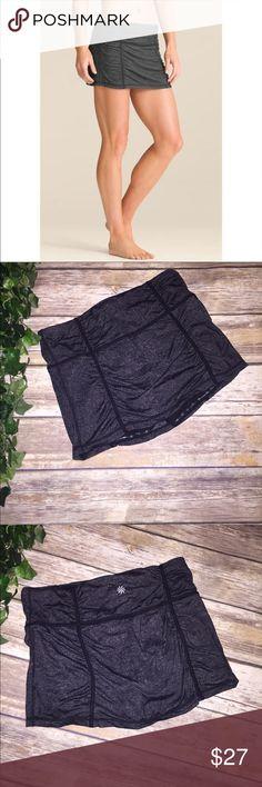 ATHLETA black yoga skort skirt Beautiful black yoga skirt/skort no flaws beautiful condition  Aprox 14 inches flat across waist  Length is aprox 11 1/2 inches Athleta Skirts