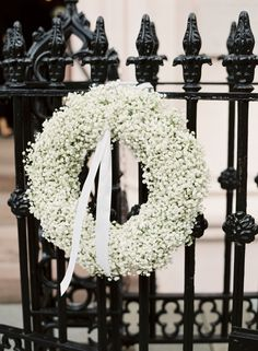 Winter baby's breath wreath: http://www.stylemepretty.com/south-carolina-weddings/charleston/2016/11/14/classic-traditional-southern-wedding-in-charleston/ Photography: Virgil Bunao - http://virgilbunao.com/