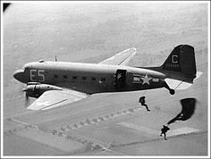 Airborne paratroopers jump from a C-47 in a training exercise. A year of intense training could not fully prepare these soldiers for what they would see in Normandy.