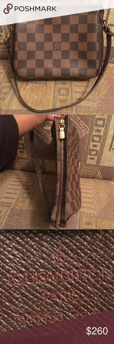 Authentic Louis Vuitton Damier Ebene Pochette Date code: SP1002. No tears or cracks in the canvas. Zipper works fine. No exposed piping. Minor wear on all four corners. Inside is clean, with one minor spot. Perfect as a makeup bag or add your favorite chain to use as a small cross-body (chain in pic is not included). Please understand this is a used bag, but still in good condition.  Sold AS-IS! Smoke and pet free home.  Please see additional post for more pictures as I want to show…