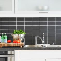 Stacked subway tiles give a sleek and contemporary aesthetic to any kitchen. To evoke this look yourself, we suggest contrasting tiles and grout as you see here, to draw attention to the modern tile layout. http://www.solidwoodkitchencabinets.co.uk/cabinets_blog/trend-watch-subway-tiles-for-oak-kitchens/