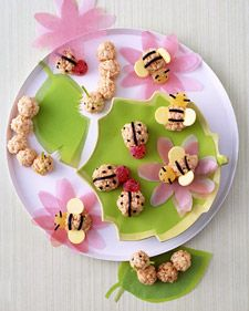 Rice cripsy treat bugs. Eyes, antennae, and stripes are licorice (poke holes with a skewer first); wings are candy wafers (cut slits with a knife), heads are gumdrops (slice gumdrop, exposing stickiness, and then press to bug body