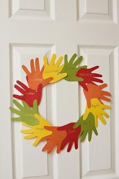 LOVE this Handprint Wreath -- great post with other Thanksgiving ideas, worksheets, and crafts for #preschool