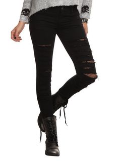 """<div>Get a layered look without the extra bulk! These black skinny jeans from Tripp have destruction details that reveal fishnet accents that make it look like you're wearing tights underneath...but you're totally not! 5-pocket styling and button and zipper fly.</div><ul><li style=""""LIST-STYLE-POSITION: outside !important; LIST-STYLE-TYPE: disc !important"""">97% cotton; 3% spandex</li><li style=""""LIST-STYLE-POSITION: outside !important; LIST-STYLE-TYPE: disc !important"""">Wash cold; dry low<..."""