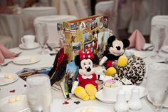 A fun idea for a wedding centerpiece is to use items from monumental moments in your life, from graduation days to vacations taken with one another.  These photos below are by K. Moss Photography.