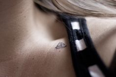 Tiny sailboat collarbone tattoo.