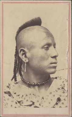 A formal portrait of a young, unidentified, Pawnee man. The Pawnee are a native North American tribe that traditionally lived along the Platte, Loup, and Republican Rivers in the central plains. The name Pawnee comes from the pa'-rik-i word meaning horn, a term that was a tribal mark in which the hair was worn in the shape of a buffalo horn.