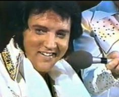 """June, 1977 Rapid City, South Dakota - """"Elvis sat down at the piano near the end [of the concert] to deliver a spellbinding rendition of """"Unchained Melody."""" As guitarist Charlie Hodge held a microphone, Elvis dug deep and poured his heart into the song. His body was falling apart, but his voice remained as powerful as ever. (I'm glad whoever mixed this video cleaned up the sound & mix)"""