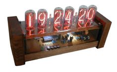 nixie tube clock with circuitrly visible in wood case