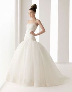 Ball gown sleeveless organza floor length bridal gown...maybe this cut would make me look taller?