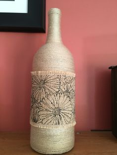 Wine bottle with yarn project. Can do anything for embellishments