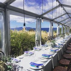 A table setting in an exotic location - Avalon Coastal Retreat on Tasmania's East Coast is a spectacular accommodation and function solution for your special day.  Image credit: @hubertanddan / IG