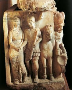 Etruscan alabaster sarcophagus detail; a warrior saying good bye to his wife. C.150BC. Volterra Etruscan Museum at Guarnacci
