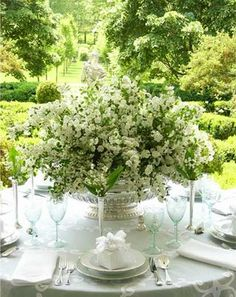 A gorgeous floral arrangement is the center of attention on a white tablescape. (Carolyn Roehm design)