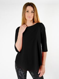 A simple jersey top has a boat neck, slightly cropped sleeves, curved hems and shaped silhouette. Made from microfiber jet jersey from Italy- a washable, stretch fabric that is extremely comfortable and wrinkle resistant. Boat Neck, Stretch Fabric, Jet, Tunic Tops, Italy, Silhouette, Simple, Sleeves, Clothes