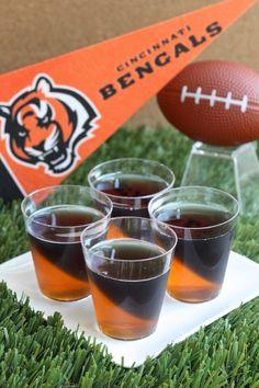 Cincinnati Bengals Jell-O Shots (3 oz. orange Jell-O 2 envelopes plain gelatin 2 cup vodka  3 1/2 Tbs grape Jell-O powder 3 1/2 Tbs lime Jell-O powder Black food coloring)