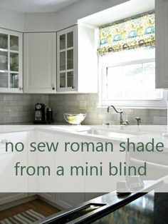 Here's another no-sew Roman shade idea. I'd sew the side seams and hem, but that's just me!