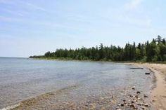 Drummond Island- comprised of 83,000 acres, 150 miles of rugged scenic shoreline, 133 square miles of forested landscape and 34 inland lakes.