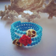 Beaded Memory Wire 3 Wrap Bracelet with Two Large Skulls and a Red Flower. $20.00, via Etsy.