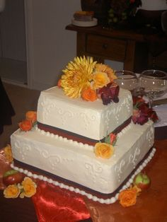 Fall Wedding Cake - Wedding cake for my sister-in-laws small wedding. There were about 30 people. Buttercream with fresh flowers. The top layer is chocolate with sour cream ganache. The bottom layer is yellow with rasberry buttercream and lemon curd.