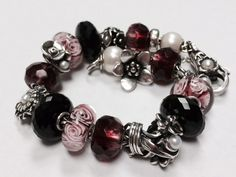 Floral-themed Trollbeads bracelet with pink, burgundy, black and pearls. Gypsy Jewelry, Beaded Jewelry, Beaded Necklace, Beaded Bracelets, Jewellery, Pandora Beads, Pandora Jewelry, Polymer Clay Bracelet, Bracelet Display