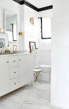 white small bathroom with black trim moldings