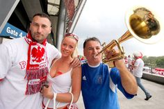 Friends for nowA Polish couple poses with a Greek fan before their two countries faced off in the opening match of the 2012 European Championship at the National Stadium in Warsaw, Poland.