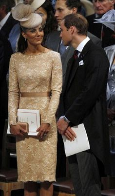 Britain's Prince William talks to his wife Catherine, Duchess of Cambridge during a thanksgiving service