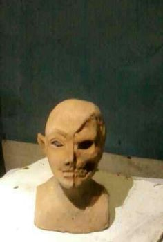 | lady | two face | elf | sculpture | stoneware | skull | half face |