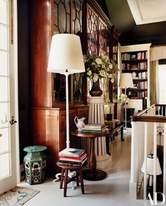 An enormous antique mahogany breakfront dominates one end of the vast library in the Long Island home of Thomas O'Brien and Dan Fink.