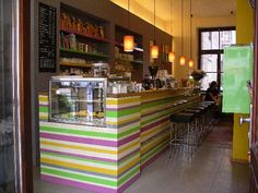 Cafe bar/deli - look at this awesome pop of color in an otherwise typical coffeehouse setup! Try something unique to stand out in a crowd.