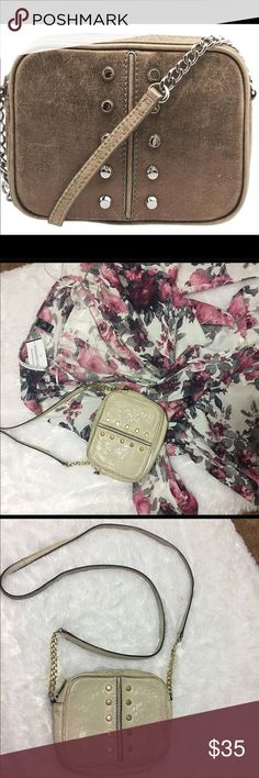 """Michael Kors crossbody bag Beautiful Preowned crossbody Michael Kors purse. This is Cream in color. Front and back are identical and measure at 7""""L x5""""H x 2""""W. there is a few slight marks and wear from being used. Michael Kors Bags Crossbody Bags"""