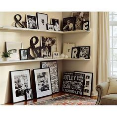 Ampersands in all their Glory. I am loving this corner shelf with TONS of framed prints.
