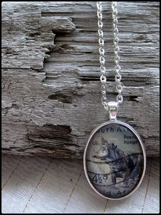 Postage Stamp Jewelry made from used and vintage postage stamps! One of a kind!