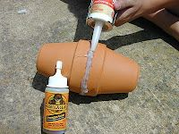 Olla Irrigation System.  I think I will try this in my gardens this year.  Quick, simple and CHEAP solution.