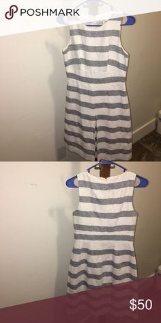 Striped nautical style dress Creme and navy striped dress. Front pleat. Good condition. Only worn once! J. Crew Dresses Midi
