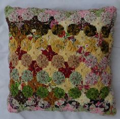 """This pillow is designed by the seller with YoYo and YoYo Embellishments.  This complete pillow is 14 1/2"""" X 14 1/2"""".  Each YoYo is individually sewn in assorted quilt fabric and filled with Poly-Fiber for a soft, bouncy and resilient pillow.  Shipping is $7.99."""