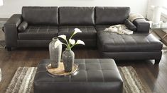 Signature Design by Ashley's Nokomis sectional provides the modern style you've been wanting for your #LivingRoom! The #furniture piece, just $1,105 at Dallas Furniture Online, is covered in espresso color bonded #leather and you can order it with the chaise on either the left or right side. Call/text 972-698-0805 or click on the pic above for complete information! #sectionals #couches #sofas #LeatherFurniture #DFW #Dallas #FortWorth Sofas, Couches, Sectional Sofa, Bonded Leather, Leather Furniture, Furniture Online, Signature Design, Espresso, Living Room Decor