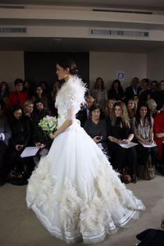 Carolina Herrera Wedding Dress Spring 2012: Strapless organza gown trimmed with ostrich feathers w/ ostrich bolero