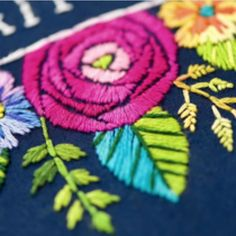 Embroidered rose with bicolored leaf
