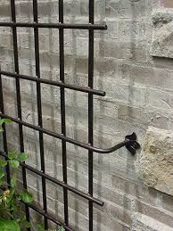 Image result for how do i support a climber next to the summer house without attaching the trellis to the wall