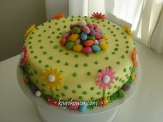 Easter cake - thinking of doing something similar to this for Easter/my Grandma's birthday & making different colored pastel layers on the inside.