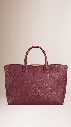 Burberry structured Tote bag in check embossed signature grain leather. Discover the women's bags collection at Burberry.com