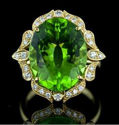 Gorgeous, bright Peridot and Diamond Ring. A bright and lively faceted oval Peridot is enthroned in a lovely, feminine 18 karat yellow gold and diamond setting with Edwardian era influences. An extravagant and regal fun ring. Peridot Jewelry, Gems Jewelry, Fine Jewelry, Jewellery, Antique Jewelry, Vintage Jewelry, Do It Yourself Jewelry, My Birthstone, Rings Cool