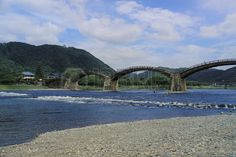 Kintai Bridge Arch bridge and Reflection Iwakuni Cityscape